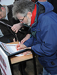 Gerry Adams TD signing the pledge at the march against the closure of the Cottage Hospital. Photo: Colin Bell/pressphotos.ie