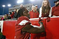 Arkansas Democrat-Gazette/THOMAS METTHE -- 11/29/2019 --<br /> Arkansas wide receiver Mike Woods (8) shakes hands with fans after the Razorbacks' 24-14 loss to Missouri on Friday, Nov. 29, 2019, at War Memorial Stadium in Little Rock.