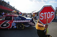 Aug 30, 2008; Fontana, CA, USA; A track worker holds a stop sign as NASCAR Sprint Cup Series driver David Ragan drives by during practice for the Pepsi 500 at Auto Club Speedway. Mandatory Credit: Mark J. Rebilas-