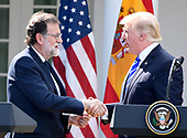 United States President Donald J. Trump, right, and President of the Government or Prime Minister Mariano Rajoy of Spain, left, shake hands at the conclusion of a joint press conference in the Rose Garden of the White House in Washington, DC on Tuesday, September 26, 2017.<br /> Credit: Ron Sachs / CNP