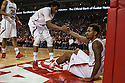 November 17, 2013: David Rivers (2)  helps teammate Ray Gallegos (15) of the Nebraska Cornhuskers up after getting knocked down from Jordan Smith (3) of the South Carolina State Bulldogs lay up at the Pinnacle Bank Areana, Lincoln, NE. Nebraska defeated South Carolina State 83 to 57.