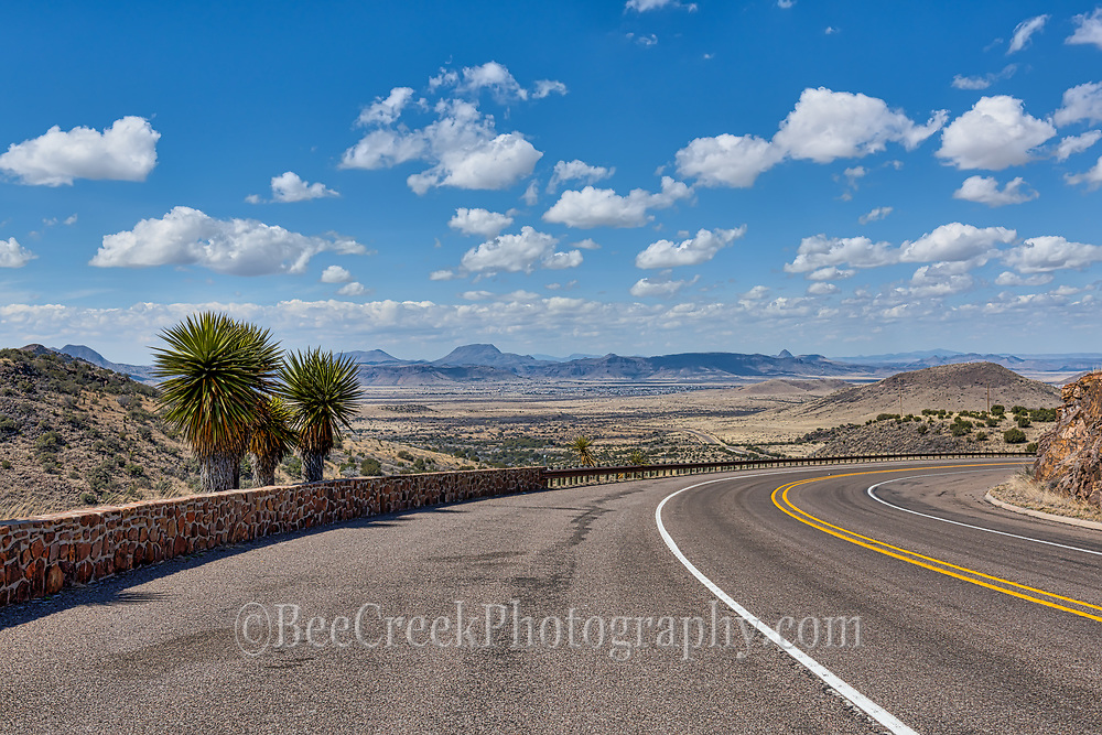 The Road to Alpine is a long flat road till you get right outside Alpine and on this day we had these beautiful blue skies with puffy white clouds so we thought scenic outlook would frame it up nicely with the yuccas on the side.
