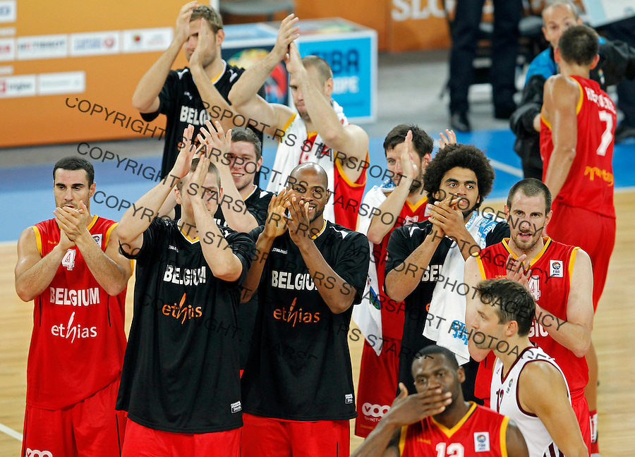 Belgium`s national basketball team players celebrate victory after European basketball championship Eurobasket 2013, round 2, group E  basketball game between Latvia and Belgium in Stozice Arena in Ljubljana, Slovenia, on September 15. 2013. (credit: Pedja Milosavljevic  / thepedja@gmail.com / +381641260959)