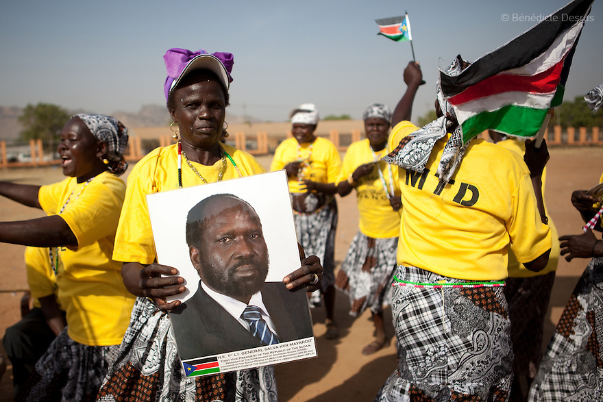 Sunday 9 january 2011 - Juba, Sudan - People from the Madi tribe wave a South Sudan flag and a photo of Salva Kiir Mayardit during the referendum at the John Garang memorial mausoleum where a polling station is being set up in Juba. About four million Southern Sudanese voters began casting their ballots Sunday in a weeklong referendum on independence that is expected to split Africa's largest nation in two. Photo credit: Benedicte Desrus
