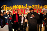 Desmond Tutu Leads a Copenhagen candlelight vigil at the Bella Center during COP 15. (Credit: Robert van Waarden/Avaaz.org)