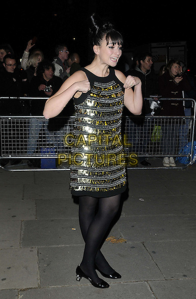 Gizzi Erskine.Cosmopolitan Ultimate Women Of The Year Awards held at the Victoria and Albert Museum (V&A), London, England..October 30th, 2012.full length black tights gold dress sleeveless sequins sequined hands arms funny mouth open.CAP/CAN.©Can Nguyen/Capital Pictures.