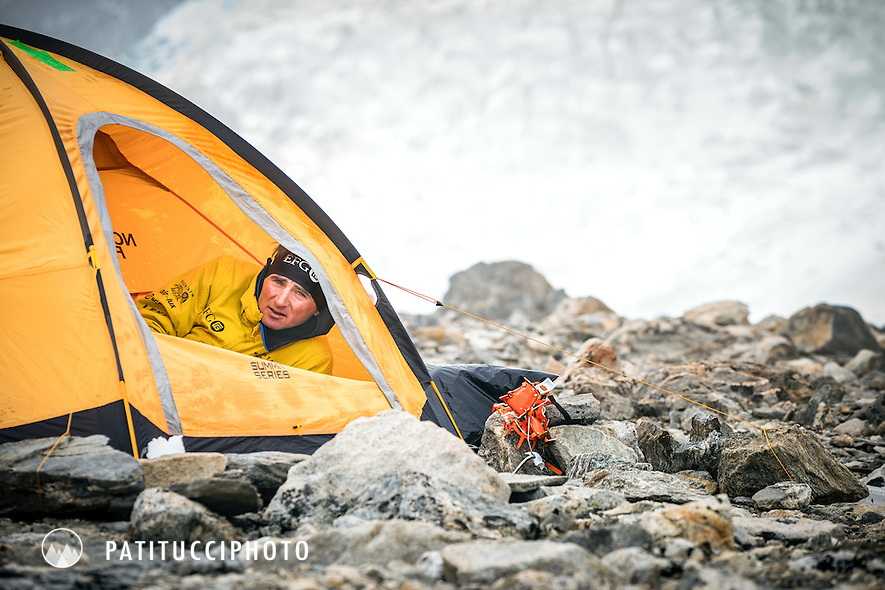 Ueli Steck inside his tent at Shishapangma's advance basecamp, relaxing and waiting for a weather window to climb, during the climbing expedition to the 8000 meter peak Shishapangma, Tibet