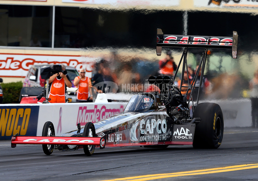Oct 4, 2013; Mohnton, PA, USA; NHRA top fuel dragster driver Billy Torrence during qualifying for the Auto Plus Nationals at Maple Grove Raceway. Mandatory Credit: Mark J. Rebilas-
