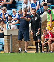 Bolton Wanderers manager Jimmy Phillips (left) protesting to an official after a foul on Bolton Wanderers' Dennis Politic<br /> <br /> Photographer David Horton/CameraSport<br /> <br /> The EFL Sky Bet League One - Gillingham v Bolton Wanderers - Saturday 31st August 2019 - Priestfield Stadium - Gillingham<br /> <br /> World Copyright © 2019 CameraSport. All rights reserved. 43 Linden Ave. Countesthorpe. Leicester. England. LE8 5PG - Tel: +44 (0) 116 277 4147 - admin@camerasport.com - www.camerasport.com