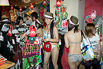 "Tokyo, Japan -  Customers in swimsuits pick out clothes to take home for free at the Desigual store in Tokyo's Harajuku fashion district. A fashion chain called ""Seminaked Party by Desigual"" offers the first 100 customers (wearing swimsuit) free clothing items at the grand opening in Tokyo, Japan, June 22, 2013. More than 4,000 people attend the Seminaked Party around the world. (Photo by Rodrigo Reyes Marin/AFLO)"