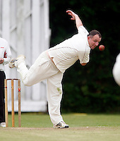 Tony Duckett bowls for Highgate during the Middlesex County Cricket League Division Three game between Highgate and Hornsey at Park Road, Crouch End, London on Sat June 5, 2010