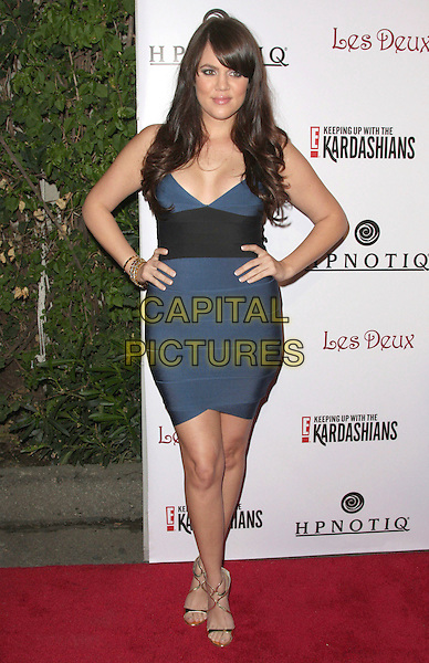 "KHLOE KARDASHIAN.""Keeping Up with the Kardashians"" E's Official Season 2 Launch Party held at Les Deux Nightclub, Hollywood, California, USA, 19 March 2008..full length black and blue dress hands on hips.CAP/ADM/`CH.©Charles Harris/Admedia/Capital PIctures"