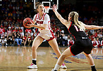 SIOUX FALLS, SD - MARCH 7: Claudia Kunzer #1 of the South Dakota Coyotes looks to pass the ball around the defense from the Omaha Mavericks at the 2020 Summit League Basketball Championship in Sioux Falls, SD. (Photo by Dave Eggen/Inertia)