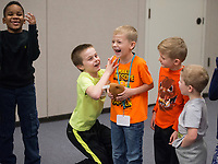 NWA Democrat-Gazette/BEN GOFF @NWABENGOFF<br /> Deuce McFadden (from left), 7, Titan Hammond, 6, Jacob Manley, 7, Garon Pedersen, 6, and brother Brennon Pedersen, 4, join in a game of 'hot potato' with other kindergarten through 2nd grade students Thursday, Feb. 22, 2018, during the biweekly 'social day' meeting of the Social Homeschoolers Network of Northwest Arkansas at the First Baptist Church of Rogers Olive Street Campus.