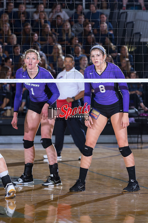Katie Vincent (1) and Gabi Mirand (8) of the High Point Panthers during the match against the UNC Greensboro Spartans at Millis Athletic Center on September 16, 2014 in High Point, North Carolina.  The Panthers defeated the Spartans 3-0.   (Brian Westerholt/Sports On Film)