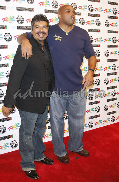 "2 July 2008 - Las Vegas, Nevada - George Lopez and Charles Barkley. Annie Duke and Don Cheadle host the 2nd Annual ""Ante Up For Africa"" Celebrity Poker Tournament during the 2008 World Series of Poker held at the Rio All-Suite Hotel and Casino. Photo Credit: MJT/AdMedia"