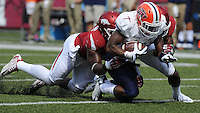 NWA Democrat-Gazette/ANDY SHUPE<br /> Arkansas' Josh Williams (left) and Josh Liddell (right) tackle University of Texas at El Paso's Aaron Jones Saturday, Sept. 5, 2015, after Jones made a catch during the second quarter of play in Razorback Stadium in Fayetteville. Visit nwadg.com/photos to see more from the game.
