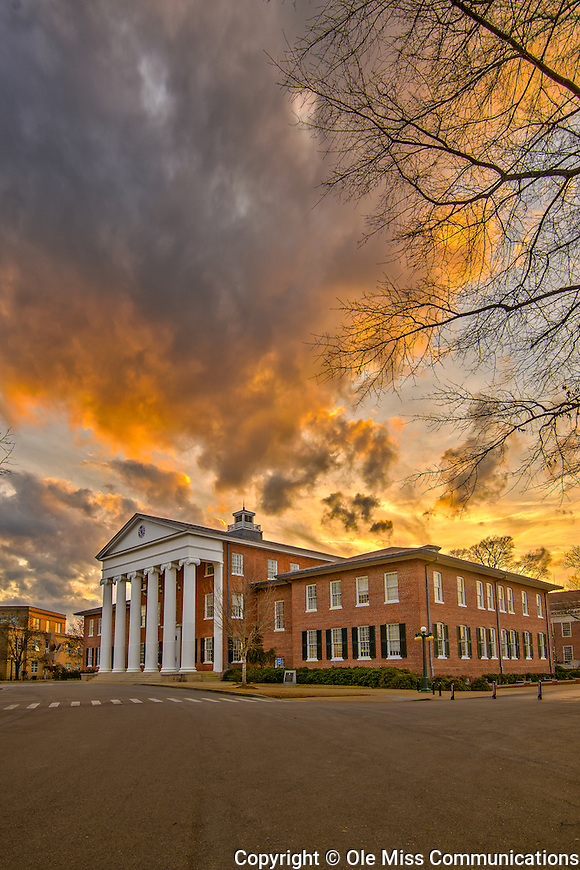 The evening sky is ablaze with color above the Lyceum. Photo by Robert Jordan/Ole Miss Communications