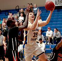 Photo courtesy of John Brown University<br /> John Brown senior Josh Bowling drives to the basket during the second half of Saturday's game against Mid-America Christian. The Evangels defeated the Golden Eagles 71-66.