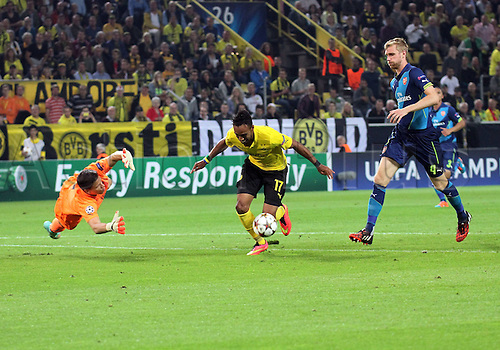 6.09.2014. Dortmund, Germany. Champions League group stages; Borussia Dortmund, versus Arsenal. Signal-Iduna-Park-Stadion Ciro Immobile and Wojciech Szeczesny (FC Arsenal London) Pierre-Emerick Aubameyang (Borussia Dortmund) Per Mertesacker (FC Arsenal London)