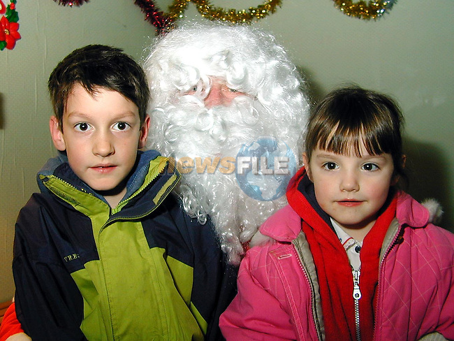 Jason and Rebecca Hanratty from the Chord Road with Santa at the christmas fair in Julianstown..Picture Paul Mohan Newsfile