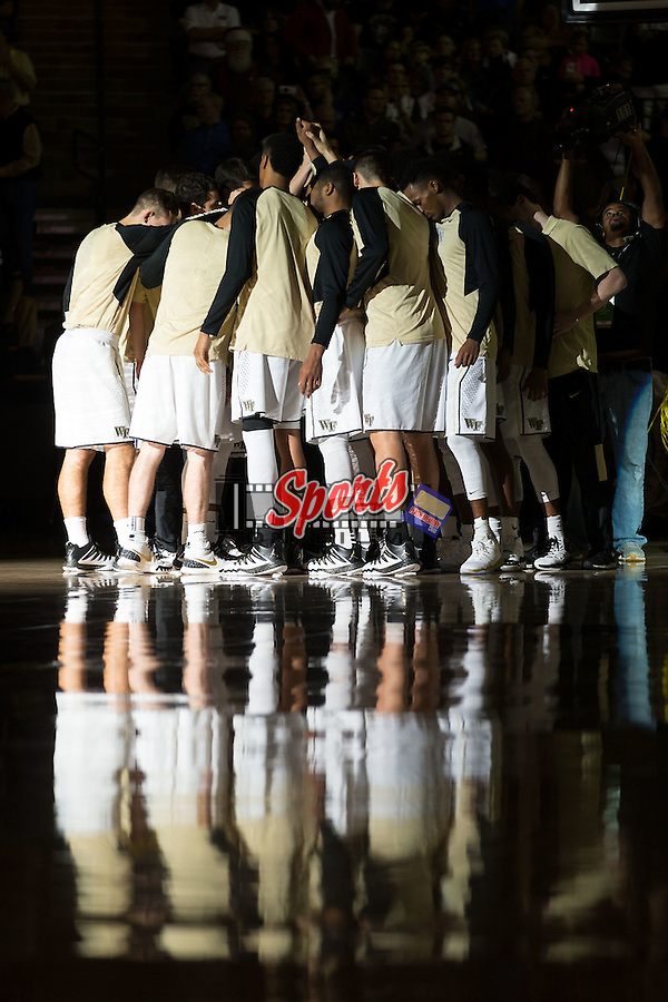 The Wake Forest Demon Deacons huddle up following player introductions prior to the start of their game against the Xavier Musketeers at the LJVM Coliseum on December 22, 2015 in Winston-Salem, North Carolina.  The Musketeers defeated the Demon Deacons 78-70.  (Brian Westerholt/Sports On Film)
