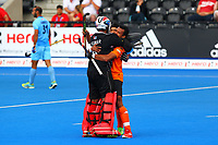 Malaysia players celebrate with their goalkeeper Kumar Subramiam at the end of the match during the Hockey World League Quarter-Final match between India and Malaysia at the Olympic Park, London, England on 22 June 2017. Photo by Steve McCarthy.