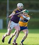 Liam Ryan of Wexford in action against Gary Cooney of Clare during the Jack Lynch Memorial game at Tulla. Photograph by John Kelly.