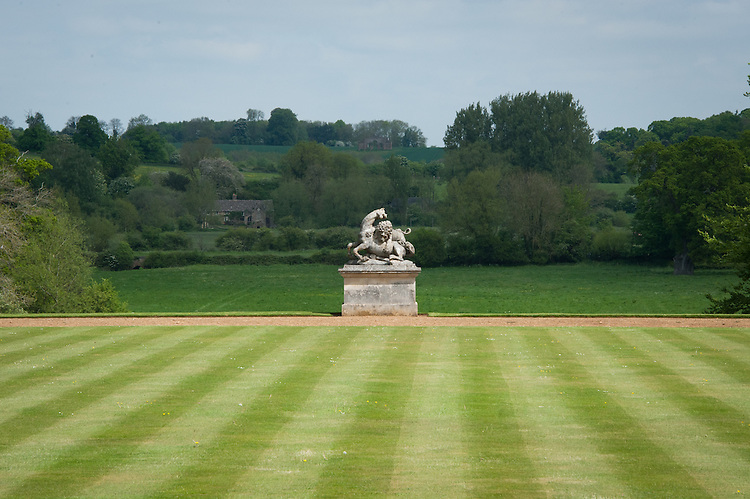 Lion and Horse sculpture by Peter Scheermakers (1740) at the end of the main lawn or Bowling Green (1720), Rousham House. The Eyecatcher folly is on top of the hill in the distance.