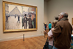 """Patrons enjoy Gustave Caillebotte's """"Paris Street; Rainy Day"""" at the Art Institute of Chicago, Chicago, IL"""