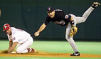 Philadelphia Phillies Travis Lee (10) breaks up the double play, causing New York Mets shortstop Mike Bordick (17) to lose his balance, Thursday, Sept. 21, 2000, in Philadelphia. Phillies won 6-5. (AP Photo/William Thomas Cain)