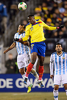Argentina midfielder Javier Mascherano (14) goes up for a header with Ecuador forward Jaime Ayovi (17). Argentina and Ecuador played to a 0-0 tie during an international friendly at MetLife Stadium in East Rutherford, NJ, on November 15, 2013.
