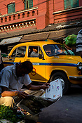 A man reads a newspaper in the New Market area of Kolkata, India, on Saturday, May 27, 2017. Photographer: Sanjit Das