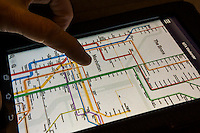 The Weekender subway app from the Metropolitan Transportation Authority is seen on a tablet on Wednesday, May 28, 2014. The app is based on the 1972 subway map design by Massimo Vignelli who reinterpreted the design for the MTA in 2011.  Vignelli also designed the wayfinding signage in the New York subway system with his designs still being used. Vignelli passed away at the age of 83 on Tuesday. He is considered one of the greatest graphic designers of all time. (© Richard B. Levine)