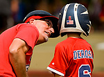 WATERBURY, CT-0712217JS10--Wolcott coach Mike Antonucci tells player Jay Derosa (6) &quot;great job&quot; on his base hit during their Roberto Clemente Tournament game against the BC Cyclones Saturday at Municipal Stadium in Waterbury. <br /> Jim Shannon Republican-American
