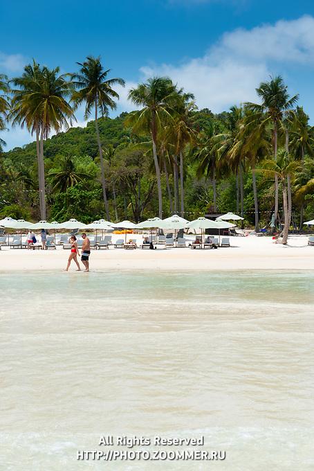 People Walk By On Bai Sao Beach, Phu Quoc, Vietnam