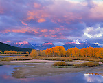 Grand Teton National Park, WY<br /> Morning sun breaks beneath the clouds onto the Teton range, viewed from above the Snake River Oxbow