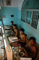 Indian gold factory workers at work.  Kolkata, India  6/13/2007  Arindam Mukherjee