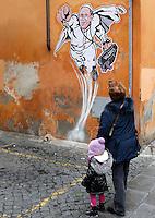 """Una donna ed una bambina osservano un disegno di Papa Francesco raffigurato come Superman, realizzato dall'artista di strada Maupal (Maurizio Pallotta) e affisso da lui stesso sulla parete di un palazzo del rione Borgo, nei pressi della Citta' del Vaticano, a Roma, 29 gennaio 2014.<br /> A woman and a child look at a street art mural by Italian street artist Maupal (Maurizio Pallotta) depicting Pope Francis as Superman, and holding a bag reading """"Values"""" on a wall of the Borgo district near the Vatican, in Rome, 29 January 2014.<br /> UPDATE IMAGES PRESS/Riccardo De Luca<br /> <br /> STRICTLY ONLY FOR EDITORIAL USE"""