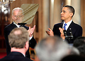 Washington, D.C. - March 23, 2010 -- United States Vice President Joseph Biden and U.S. President Barack Obama applaud prior to the President signing the version of the health care bill that was passed by the U.S. House of Representatives in the East Room of the White House in Washington, D.C. on Tuesday, March 23, 2010..Credit: Ron Sachs / CNP.(RESTRICTION: NO New York or New Jersey Newspapers or newspapers within a 75 mile radius of New York City)
