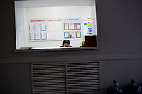 A receptionist waits for visitors to a Bashneft oil refinery outside Ufa, Bashkortostan, Russia.