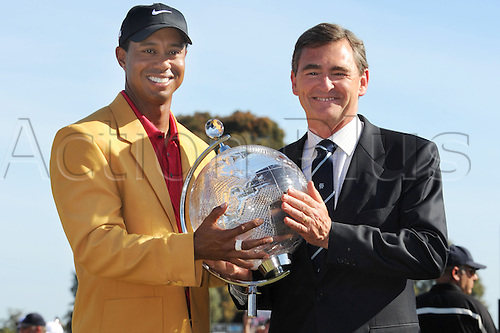 Nov 15, 2009 - Melbourne, Australia - TIGER WOODS, JOHN BRUMBY and the winners trophy during the final round of the Australian Masters at the Kingston Heath Golf Club. Woods won for the seventh time this year, and the 82nd time worldwide in his career. Woods now has a trophy from every golfing continent. This is his first win in Australia, the 13th country where he has won an individual event. Photo: Matthew Mallett/Actionplus
