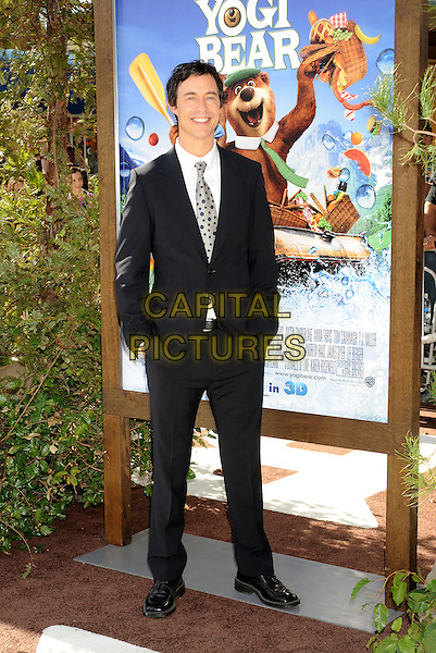 "TOM CAVANAGH .arriving at the Los Angeles premiere of ""Yogi Bear"" in Westwood Village, California, USA, December 11th, 2010. .full length black suit tie hands in pockets .CAP/ROT/TM.©TM/Roth StockCapital Pictures"