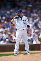 Chicago Cubs pitcher Jon Lester (34) looks in for the sign during a game against the Milwaukee Brewers on August 13, 2015 at Wrigley Field in Chicago, Illinois.  Chicago defeated Milwaukee 9-2.  (Mike Janes/Four Seam Images)