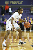 SEATTLE, WA - DECEMBER 18: Washington's #2 Aarion McDonald brings the ball down court against Savannah State.  Washington won 87-36 over Savannah State at Alaska Airlines Arena in Seattle, WA.