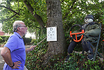 SCARECROW VILLAGE FESTIVAL IN HORDLE, HAMPSHIRE.<br /> <br /> Pictured: Malcolm Warne-Holden, 74, pointing at the eye test board for his homemade scarecrow of Dominic Cummings and the 'eye test'.<br /> <br /> Entries this year to a village scarecrow competition seem to have taken a Covid-19 theme, with entries showing Dominic Cummings holding a steering wheel next to an eye chart, key workers stood 2 metres apart and politicians stood at lecterns.<br /> <br /> The pandemic appears to have also played a part in the number of entries this year which is down from twenty last year to eight, but families and businesses have still produced a range of scarecrows for the competition.<br /> <br /> The competition this year is raising money for PATCH - Parents and Teachers in the Community of Hordle, and is organised by the Hordle and District Twinning Association.<br /> <br /> © Ewan Galvin/Solent News & Photo Agency<br /> UK +44 (0) 2380 458800