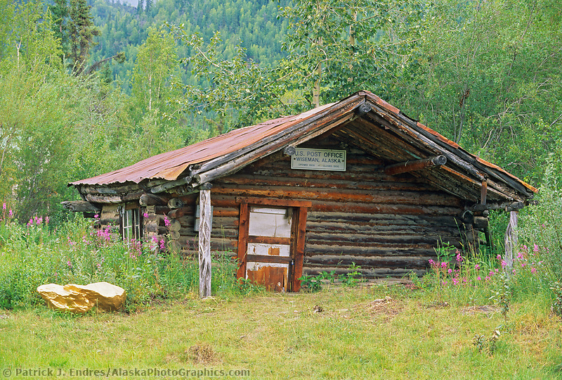 Historic log cabin post office in the small mining town of Wiseman, Brooks Range, Alaska
