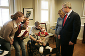 United States President George W. Bush and first lady Laura Bush talk with United States Army Sergeant Dale Beatty of Statesville, North Carolina, and, from left, sister-in-law Wendolyn Summers, wife Belinda Beatty, son Lucas, 6 months old, and son Dustin, 2 years old, during a visit to the Fisher House at Walter Reed Army Medical Center in Washington, D.C., Tuesday, December 21, 2004. President Bush presented Sergeant Beatty The Purple Heart for injuries he sustained while serving in Operation Iraqi Freedom.<br /> Mandatory Credit: Paul Morse / White House via CNP