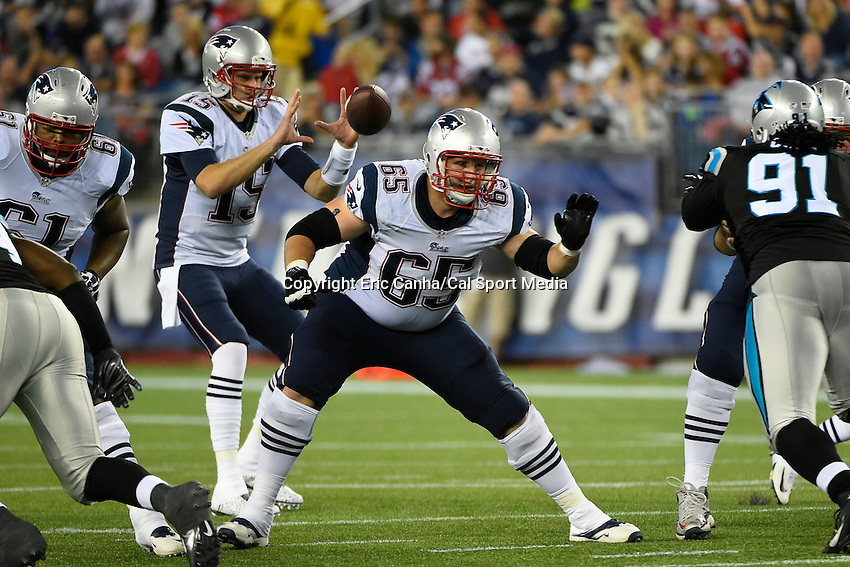 August 22, 2014 - Foxborough, Massachusetts, U.S.- New England Patriots offensive tackle Jordan Devey (65) blocks for quarterback Ryan Mallett (15) during the NFL pre-season game between the New England Patriots and the Carolina Panthers held at Gillette Stadium in Foxborough Massachusetts. The Patriots defeated the Panthers 30-7 in regulation time. Eric Canha/CSM
