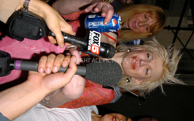 Courtney Love during her chaotic press conference after Love appeared before judge in Manhattan Criminal Court facing charges of injuring a fan back in March 2004 during her concert at East Village nightclub, Plaid. While performing a number of songs, the 39-year-old rocker wildly flung her microphone stand into the audinece injuring 24-year-old concertgoer. New York, May 13, 2004. Please byline: AJ SOKALNER/ACE Pictures.   .. *** ***..All Celebrity Entertainment, Inc:  ..contact: Alecsey Boldeskul (646) 267-6913 ..Philip Vaughan (646) 769-0430..e-mail: info@nyphotopress.com